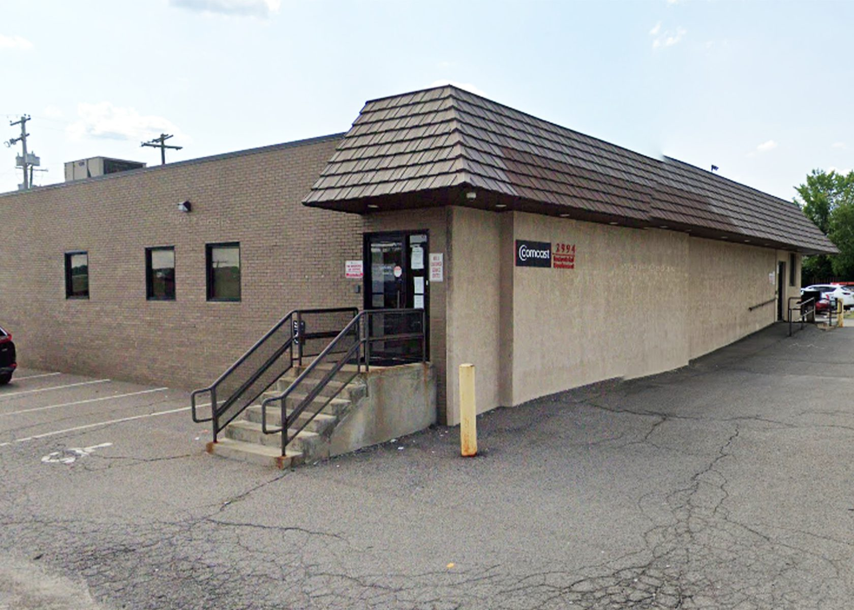 Front entrance of 2994 Industry Boulevard, a single story, brown brick building